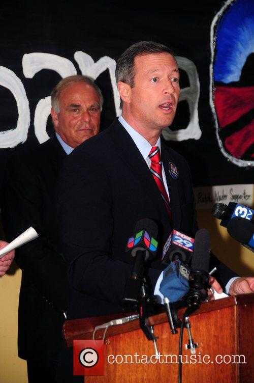 Martin O'Malley at a press conference discussing John...