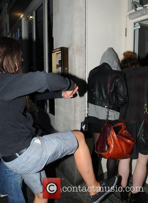 Pixie Geldof, a friend are huddled in a corner while a drunk passer by hurles abuse and attempts to kick the pair. Pixie was leaving Groucho Club after a night out with friends. 2