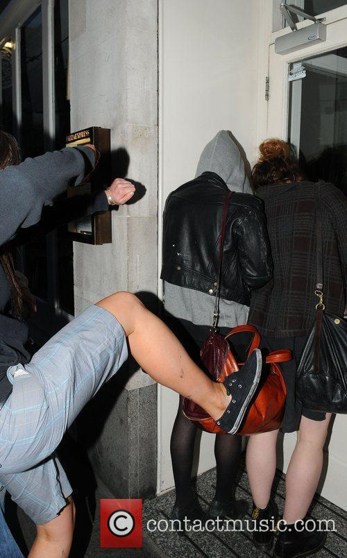 Pixie Geldof, a friend are huddled in a corner while a drunk passer by hurles abuse and attempts to kick the pair. Pixie was leaving Groucho Club after a night out with friends. 3