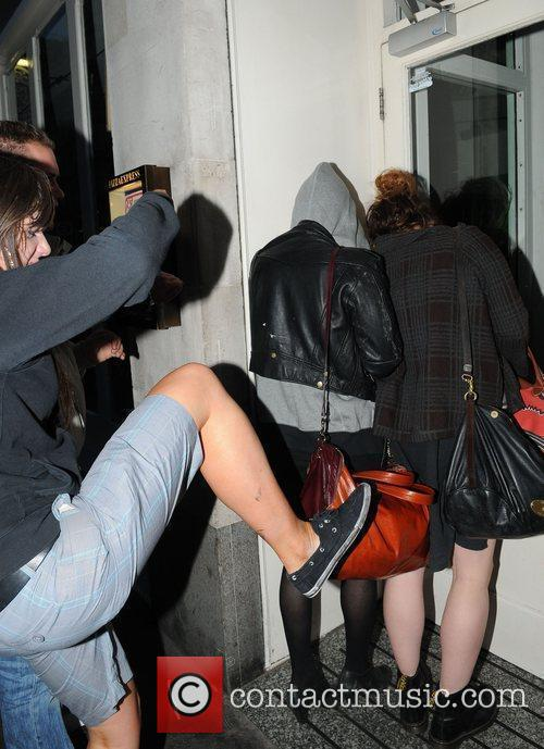 Pixie Geldof, a friend are huddled in a corner while a drunk passer by hurles abuse and attempts to kick the pair. Pixie was leaving Groucho Club after a night out with friends. 6