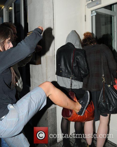 Pixie Geldof, a friend are huddled in a corner while a drunk passer by hurles abuse and attempts to kick the pair. Pixie was leaving Groucho Club after a night out with friends. 4