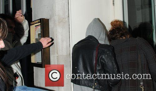 Pixie Geldof, a friend are huddled in a corner while a drunk passer by hurles abuse and attempts to kick the pair. Pixie was leaving Groucho Club after a night out with friends. 1