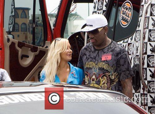Dennis Rodman speaks to a model Gumball 3000...
