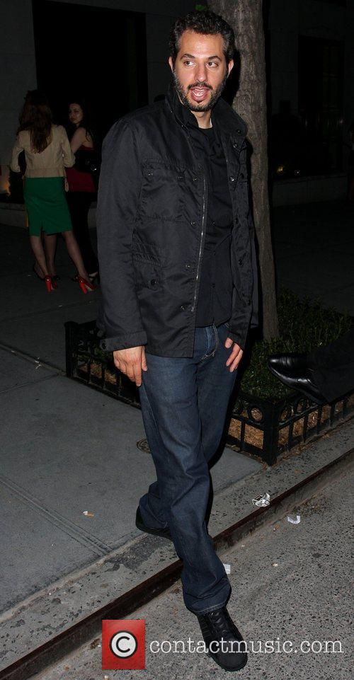 Guy Oseary getting into a cab with a...
