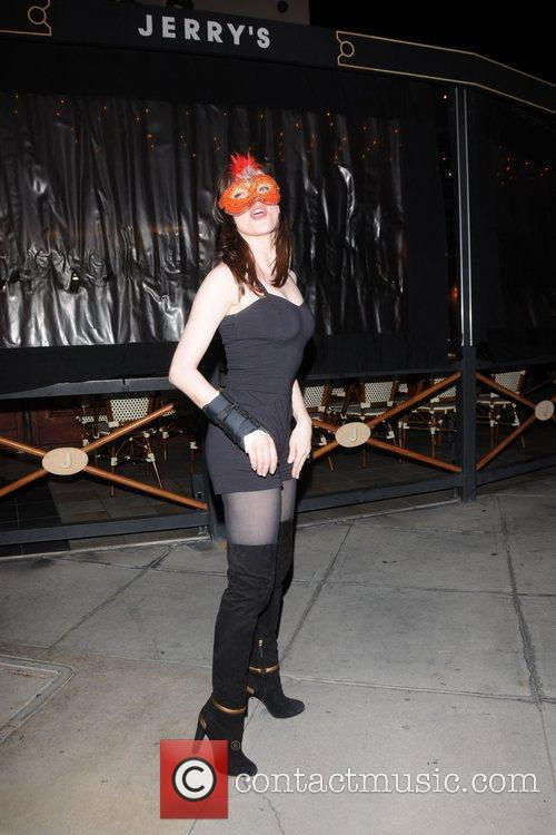 Rose McGowan wears a masquerade mask outside of...