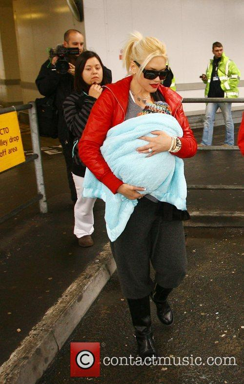 Arriving at Heathrow airport with their family