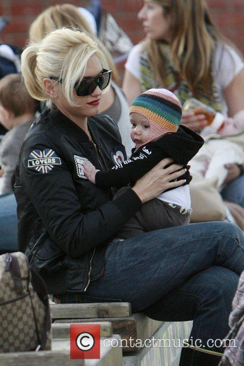 Gwen Stefani  plays with Zuma Rossdale in...