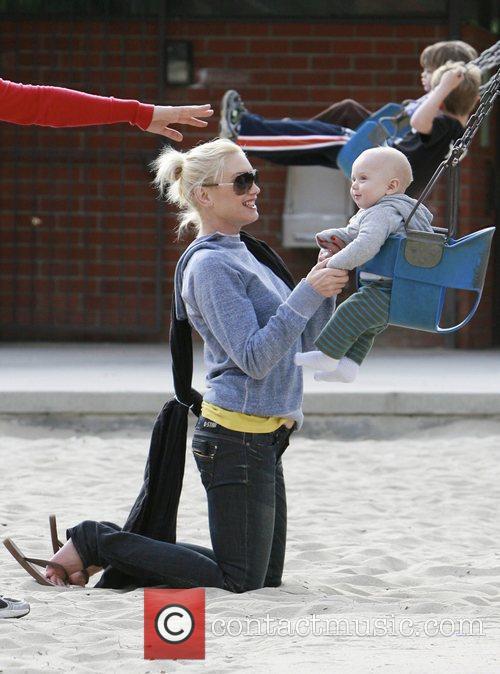 Gwen Stefani pushes baby Zuma in a swing...