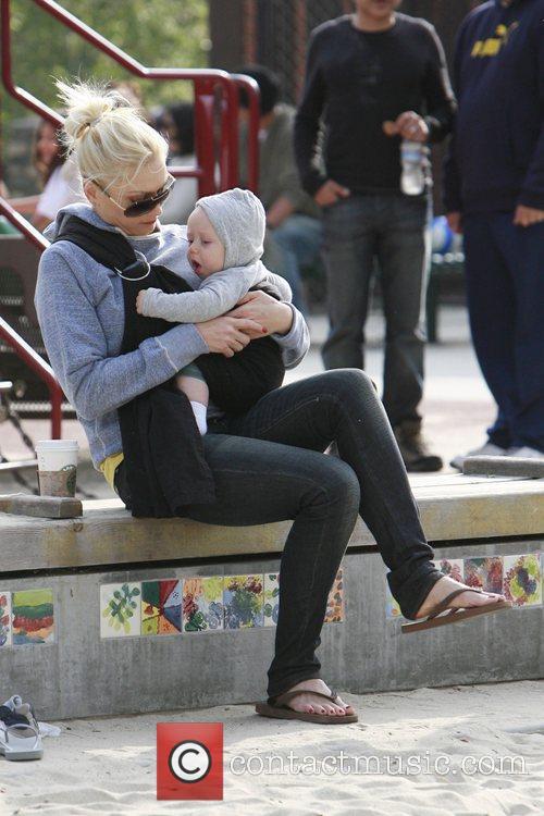 Gwen Stefani holds baby Zums in a baby...