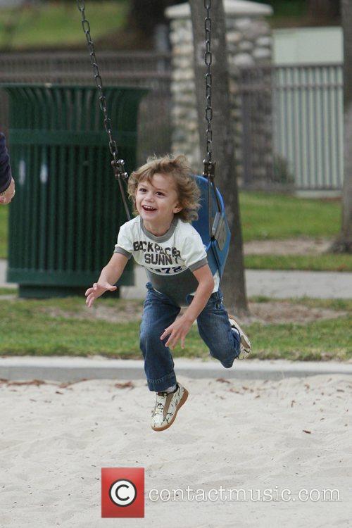 Kingston Rossdale enjoying himself on a swing at...