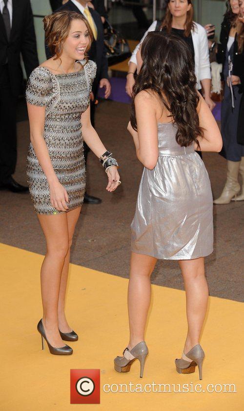 Miley Cyrus and Demi Lovato at the premiere...