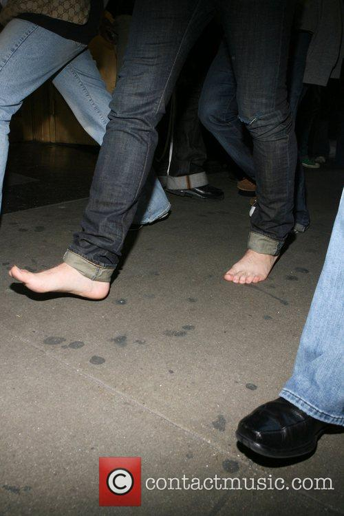 The Hanson Brothers walk one mile barefoot though...