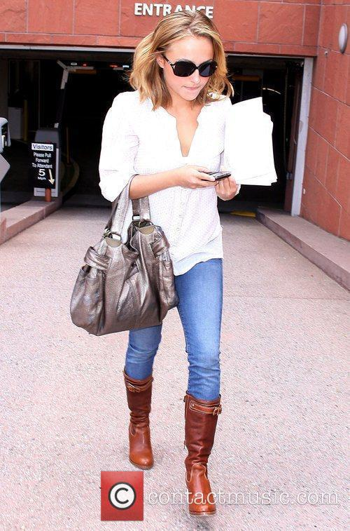 Hayden Panettiere leaving a business meeting holding some...