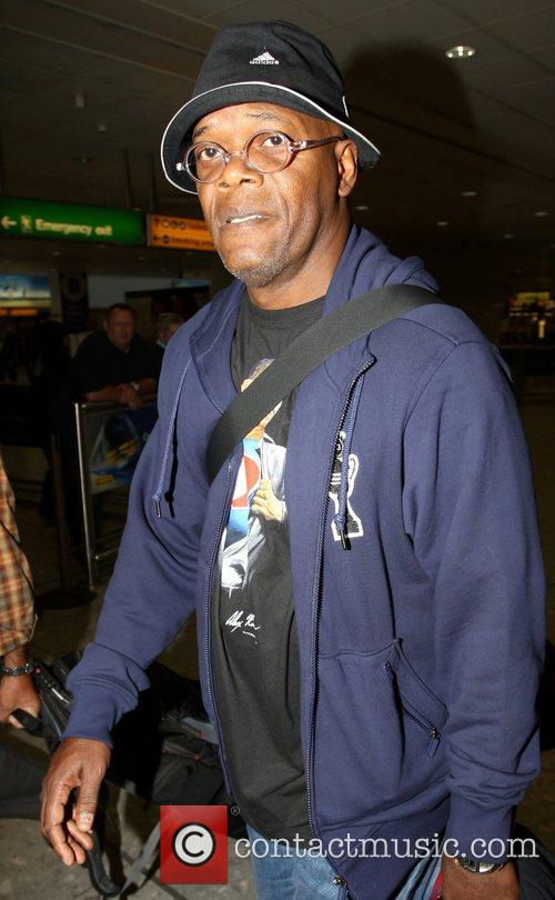 Samuel L. Jackson arriving at London's Heathrow airport...