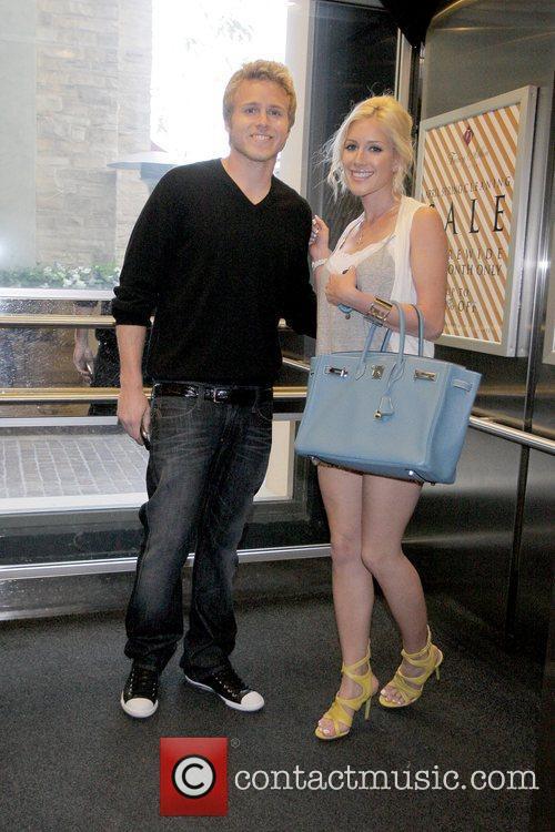 Spencer Pratt and Heidi Montag walk through The...