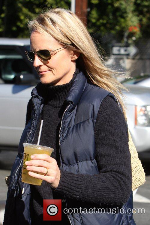 Helen Hunt  carrying a cup of lemonade...