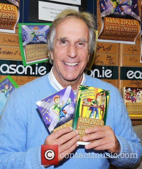 Henry Winkler, aka The Fonz, signs copies of...