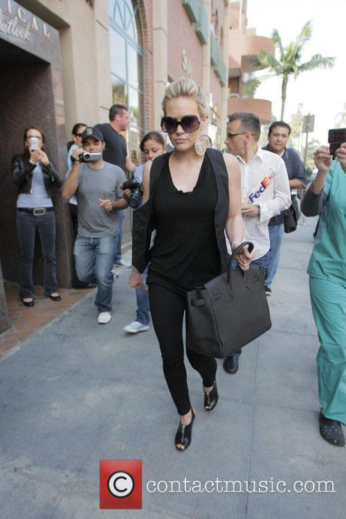 Enters a medical building in Beverly Hills