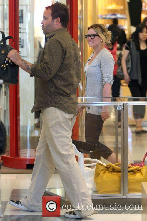 Hilary Duff shopping for shoes and handbags at...