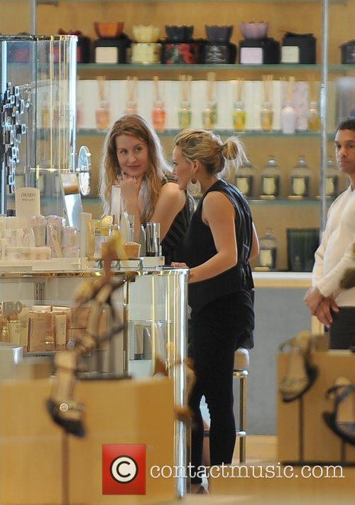 Hilary Duff shops with a friend at Barneys...