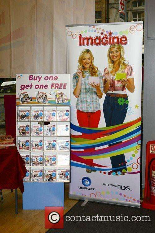 Holly Willoughby and Fearne Cotton signing copies of...