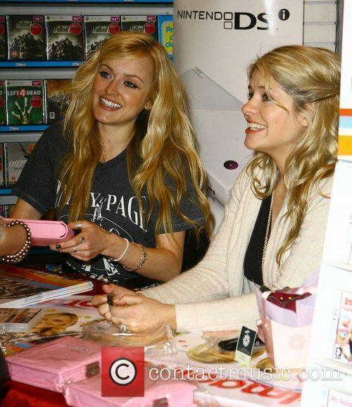 Fearne Cotton and Holly Willoughby signing copies of...