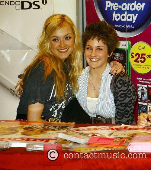 Fearne Cotton  signing copies of the Nintendo...