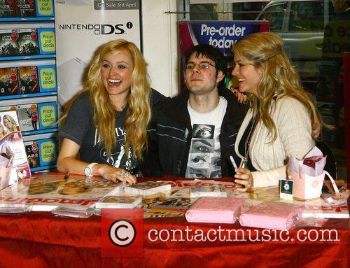Signing copies of the Nintendo DS Imagine game