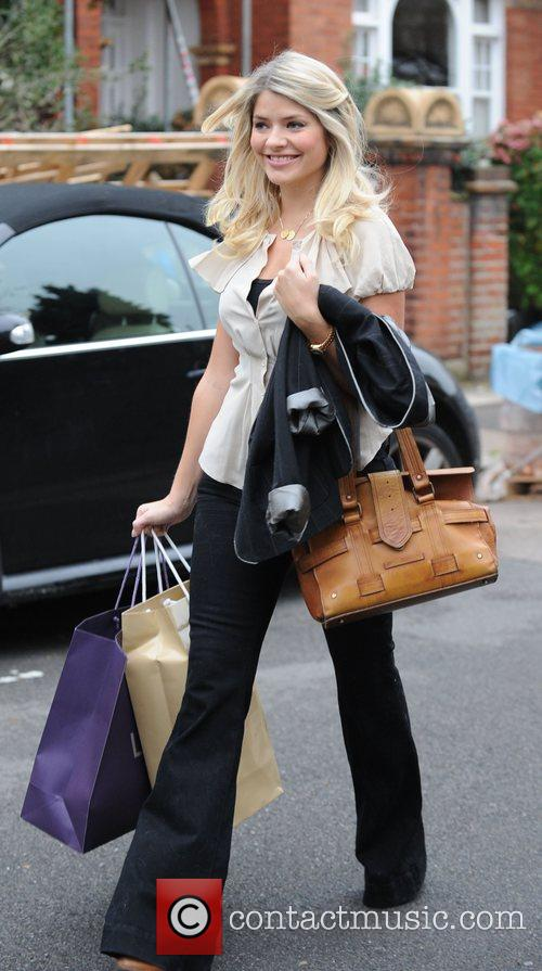 Holly Willoughby leaving her house after confirming she...