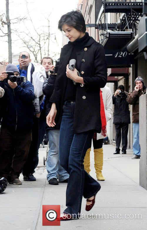 Katie Holmes visits a private school and performing...