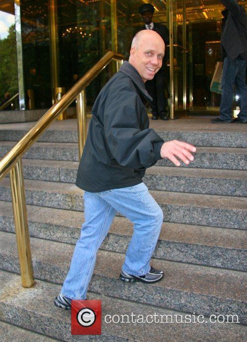 Figure Skater Scott Hamilton outside his Manhatten hotel...