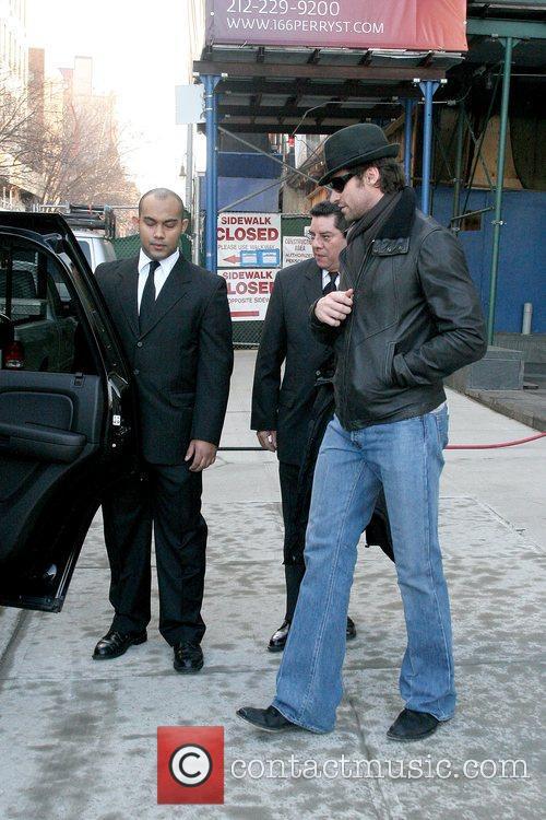 Hugh Jackman leaving his Manhattan apartment with his...