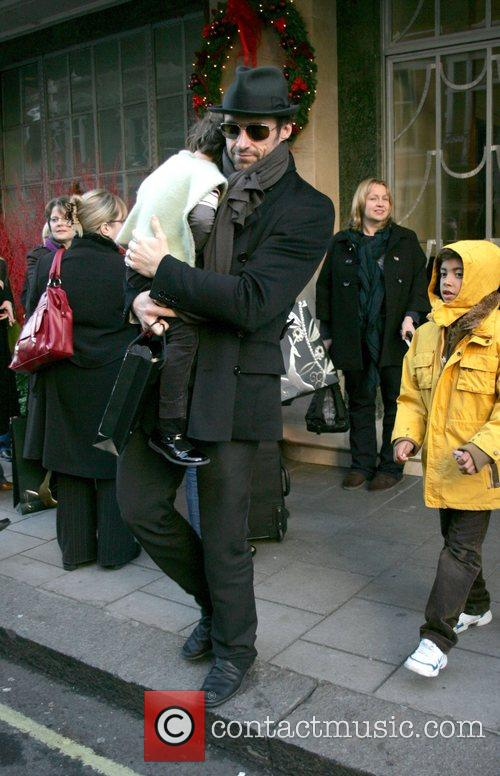 Leaving his hotel with daughter Ava Jackman