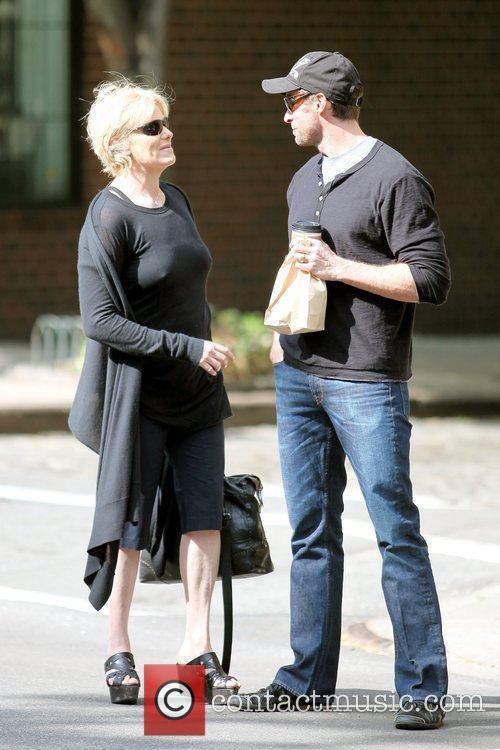 Hugh Jackman hails a taxi for his wife...