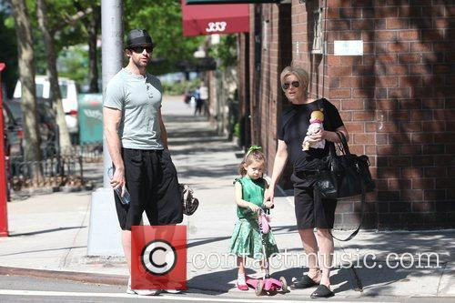 Hugh Jackman, carrying a picnic blanket, and his...