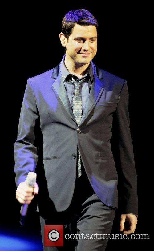 Sebastien Izambard IL Divo performing live on stage...