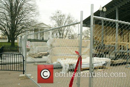 Work continues on the 2009 inaugural stands outside...