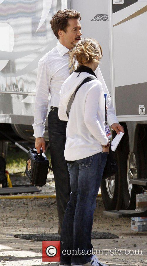 Robert Downey Jr walking outside his trailer smoking...