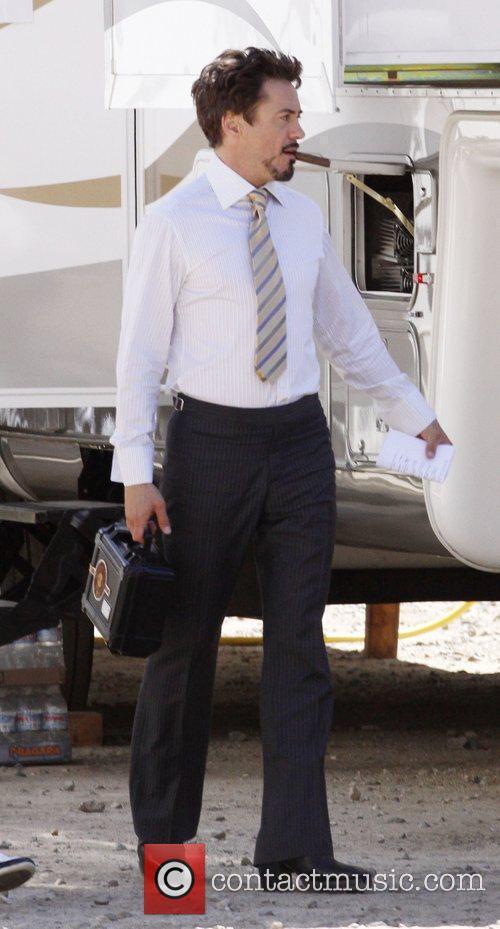 Robert Downey Jr - Robert Downey Jr walking outside his ... Robert Downey Jr Cigars