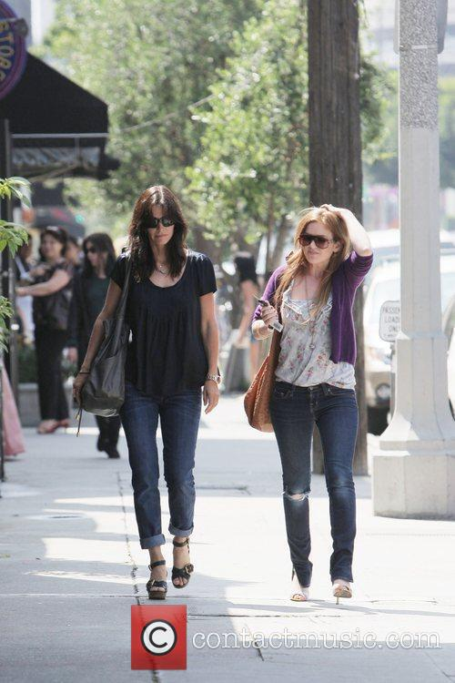 Courteney Cox and Isla Fisher  share a...