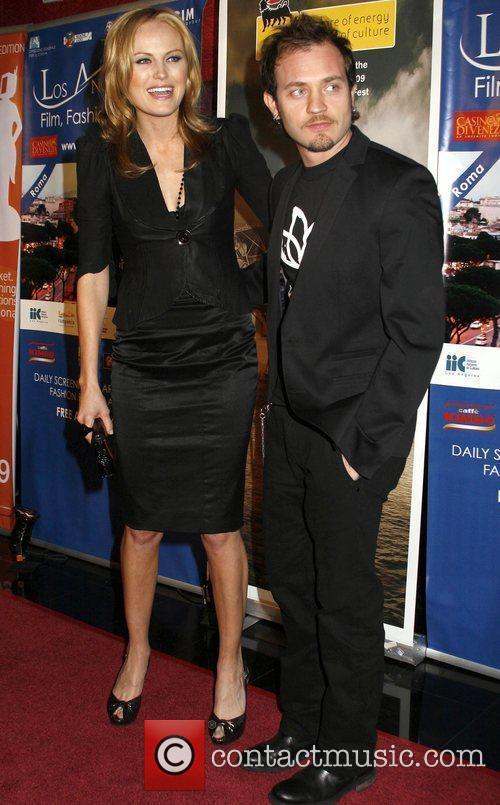 Malin Ackerman and guest attends the 4th Los...