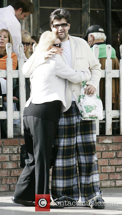 Barbara Davis and Jason Davis outside The Ivy...