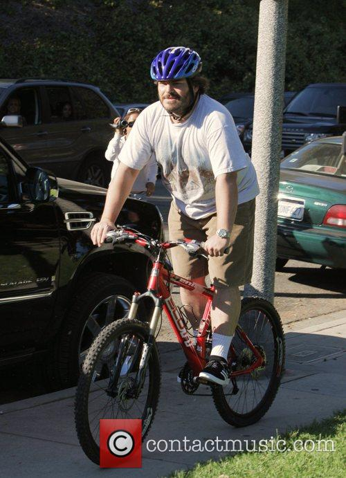 Rides his mountain bike through Coldwater Cayon Park.