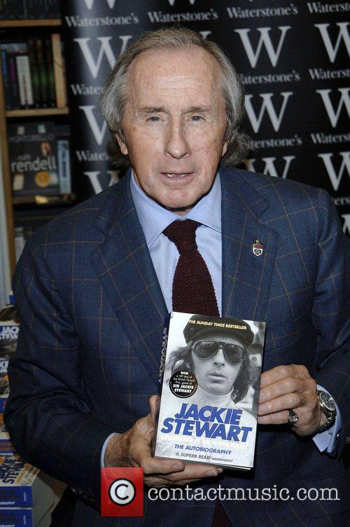 Jackie Stewart  signs copies of his autobiography...