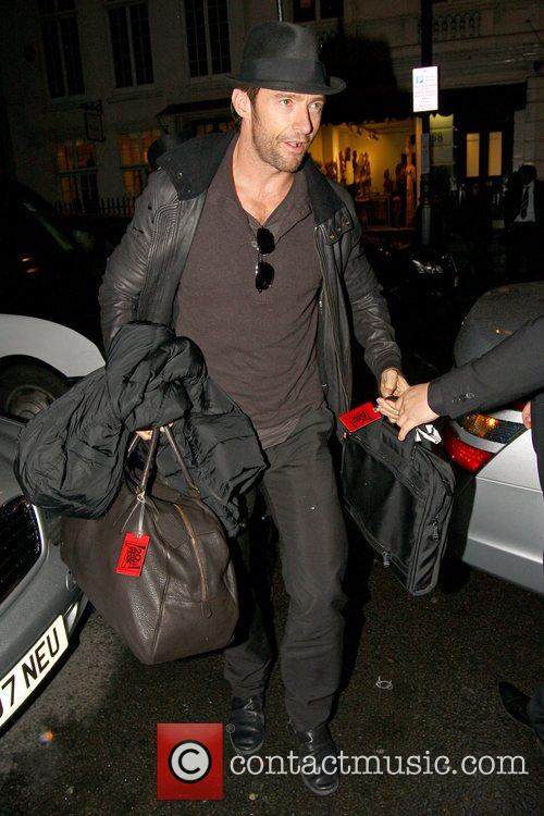 Arrives at his hotel carrying luggage