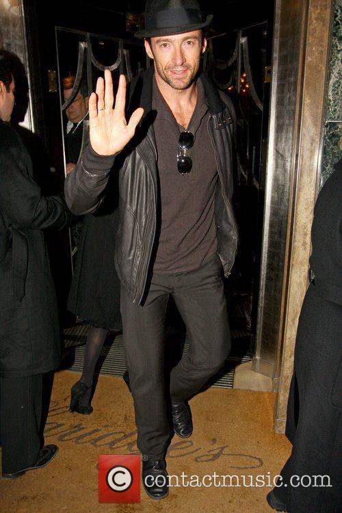Hugh Jackman arrives at his hotel wearing a...