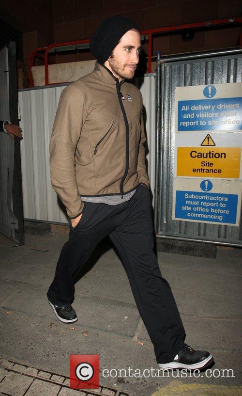 Jake Gyllenhaal leaves Cipriani restaurant via the back...