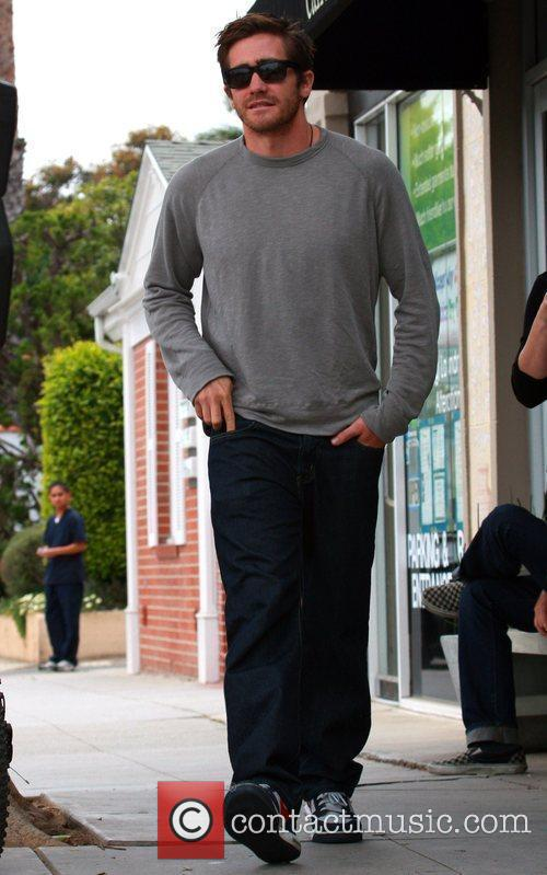 Jake Gyllenhaal leaves a coffee shop after meeting...