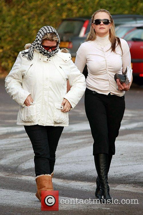 Jodie Gray (r) and friend arrive at Bicester...