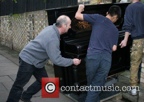 Has a piano delivered to girlfriend, Kate Moss'...